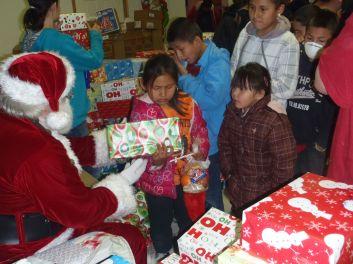 Santa Distributing Gifts 2012